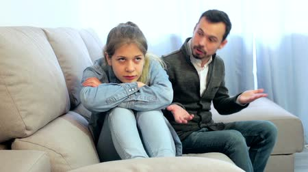 país : Young father having disagreement with daughter teenager at home