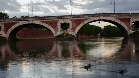 neuf : View of historic Pont Neuf over Garonne River in Toulouse on rainy spring day Stock Footage