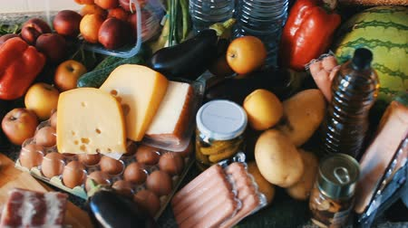 cheese packaging : Image of a full table of grocery on the kitchen at home. Stock Footage
