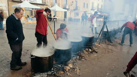 úterý : CASTELLTERCOL, SPAIN - FEBRUARY 13, 2018: Traditional celebration of escudella on square of Castelltercol city, Catalonia Dostupné videozáznamy