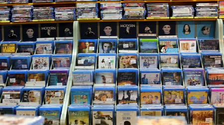serial : BARCELONA, SPAIN - FEBRUARY 15, 2018: CD and DVD store offering huge selection of movies on its shelves