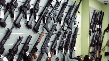 pneumatic : pneumatic guns hangs on the wall in military shop Stock Footage