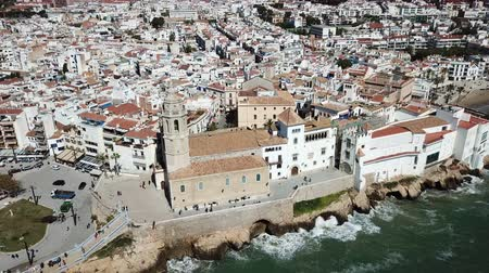 felhőtlen : Aerial view of Sitges small town with church on Mediterranean coastline, Spain Stock mozgókép