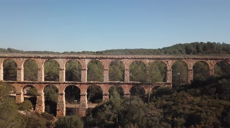 forestal : View of Pont del Diable with two levels of arches, antique Roman aqueduct near Spanish town of Tarragona Stock Footage