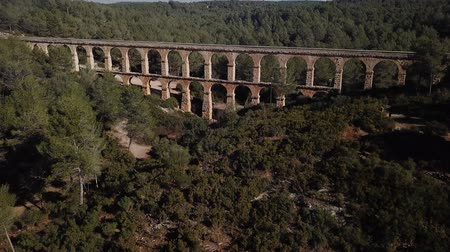 pont : View of Pont del Diable with two levels of arches, antique Roman aqueduct near Spanish town of Tarragona Stock Footage
