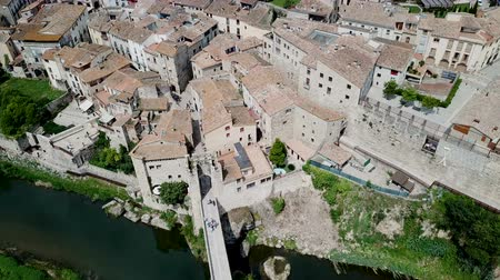 fortresses : View from drone of medieval Spain town of Besalu with Romanesque bridge over Fluvia river