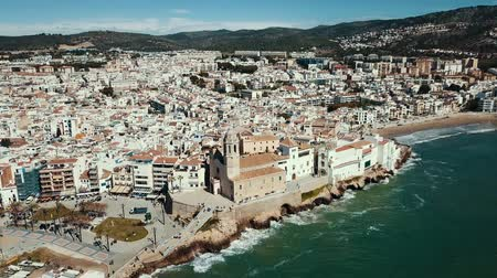 felhőtlen : Panorama of the coastal city of Sitges with the building of the church, Barcelona, ??Spain Stock mozgókép