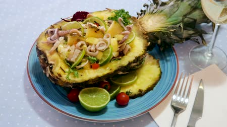 kalmar : Salad with squid, pineapple and lime dressed with sauce of pineapple and lime juice, olive oil, chili pepper