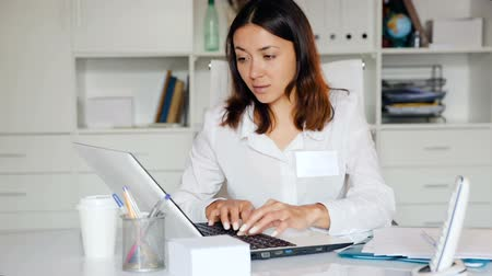 recepce : Attentively female doctor working at laptop in her office
