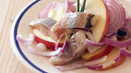 seafood dishes : Traditional Norwegian dish - Salad Herring with apples Stock Footage