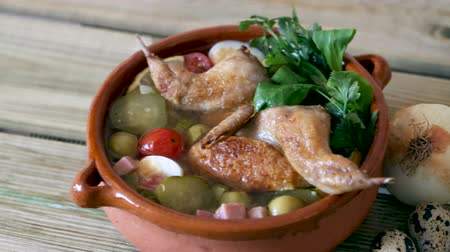 fürj : Delicious solyanka on broth from quail with ham, cherry tomatoes, olives and quail eggs served with fresh herbs