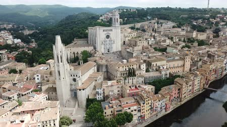 reddish : Aerial view of the main landmarks of Girona - Saint Mary Cathedral and Collegiate Church of Sant Feliu on Onyar river, Spain