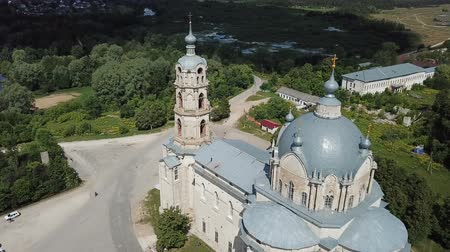 forestal : Belfry and dome of Church of Life-Giving Trinity in Gus-Zhelezny on background with greenery and cloudy summer sky, Russia Stock Footage