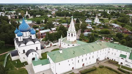 architectural heritage : Aerial panoramic view of the Cathedral of the Nativity of the Virgin in Suzdal Kremlin on a cloudy summer day, Russia Stock Footage