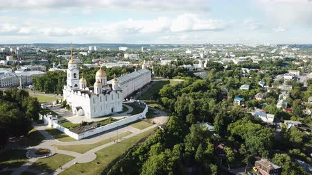 klyazma : View of Dormition Cathedral on a background with Vladimir cityscape in sunny summer day, Russia Stock Footage
