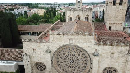 romanesk : View from drone of cityscape of Sant Cugat del Valles with ancient Monastery in summer day, Spain