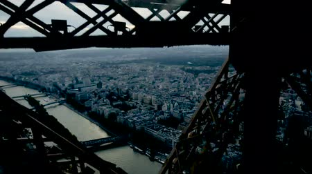 truss : Architecture of Eiffel Tower. Closeup view of metal frames, beams, rivets against blue sky as background Stock Footage