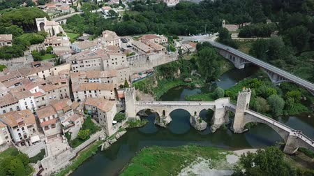 angular : View from drone of medieval Spain town of Besalu with Romanesque bridge over Fluvia river