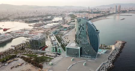 w : Aerial view of the city of Barcelona with the city of Barcelona on Barceloneta Beach in summer Stock mozgókép