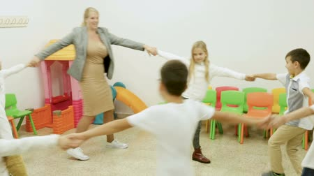 acadêmico : Group of children during recess Stock Footage