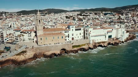 hegytömb : Panorama of the coastal city of Sitges with the building of the church, Barcelona, ??Spain Stock mozgókép