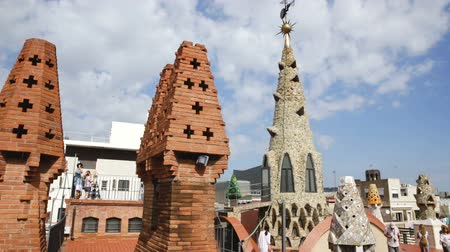 monumentális : BARCELONA, SPAIN - SEPTEMBER 02, 2018: Magical rooftop of Palau Guell with chimneys and central spire designed by architect Antoni Gaudi
