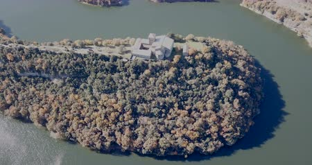 dobrar : Aerial view of Sant Pere de Casserres monastery on Ter river in autumn, Spain