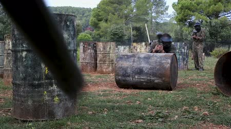 paintball : Portrait of a team of adult people playing paintball battlefield outdoor Stock Footage