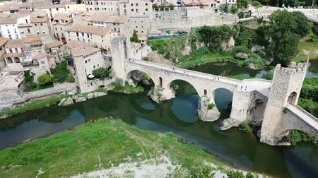 угловой : View from drone of medieval Spain town of Besalu with Romanesque bridge over Fluvia river