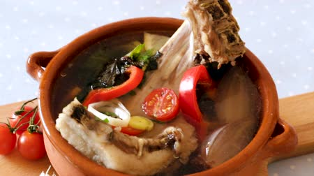 caldo : Lambs soup cooked with vegetables, onion and lemon, served in bowl