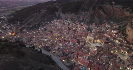 body building : Spanish town of Daroca with illuminated Basilica of St. Mary of Sacred Body Stock Footage