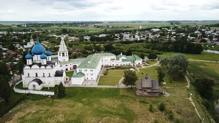 church of the nativity : Aerial view of Suzdal Kremlin with Cathedral of Nativity, oldest part of medieval Russian city of Suzdal Stock Footage