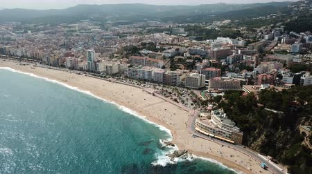 フォート : View from the drone of the Spanish island of Lloret de Mar on the Mediterranean coast in the summer day 動画素材