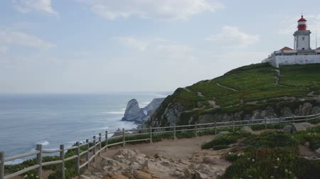 континентальный : Scenic view of the lighthouse at Cape Cabo da Roca in sunny spring day, Portugal