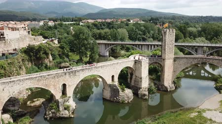 fortificado : View from drone of medieval Spain town of Besalu with Romanesque bridge over Fluvia river
