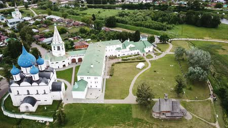 church of the nativity : Aerial panoramic view of the Cathedral of the Nativity of the Virgin in Suzdal Kremlin on a cloudy summer day, Russia Stock Footage