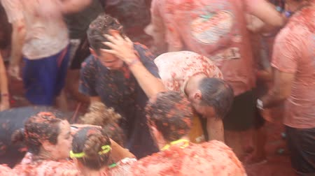 mob : BUNOL, SPAIN - AUGUST 29, 2018: People during the La Tomatina festival. La Tomatina festival