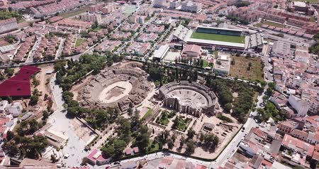 emerita : Aerial view of the ruins of an antique Roman amphitheater and the Theater on Merida cityscape, Spain