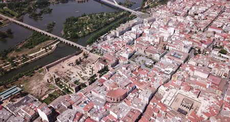emerita : Aerial panoramic view of the city of Guadiana River with ancient pedestrian Roman Bridge, Spain