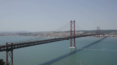 largest city : Famous Abril bridge in Lisbon, crossing the Tagus River, Portugal Stock Footage