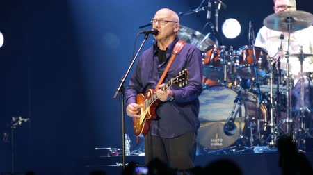 mítosz : BARCELONA, SPAIN - APRIL 26, 2019: Mark Knopfler during performance at Palau Sant Jordi, Barcelona