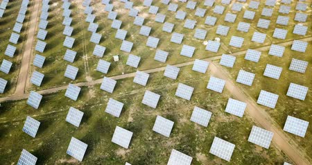 retailer : Modern solar power station in field, view from drone