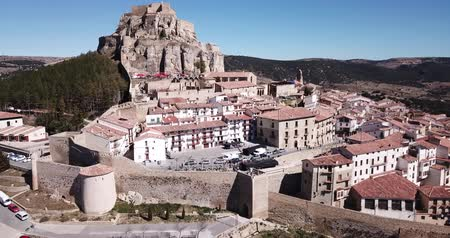 antikvitás : Aerial view of Morella cityscape with ancient fortified castle on top of rock in sunny day, Spain