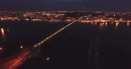 suyolu : Night aerial view from Almada of Sanctuary of Christ King and 25 de Abril Bridge against backdrop of lighted Lisbon, Portugal
