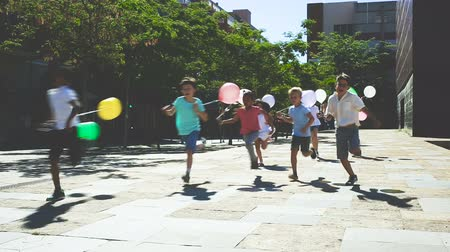 parentes : Happy children running in race and laughing outdoors at sunny day