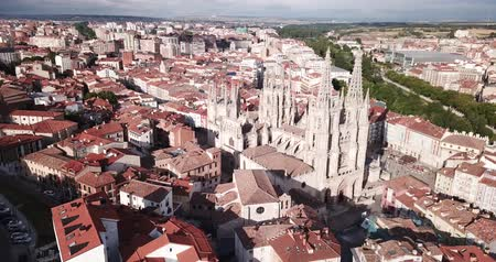 binalar : Picturesque aerial view of summer Burgos cityscape overlooking Gothic steeples of Cathedral of Saint Mary, Spain Stok Video