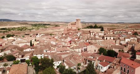 tartomány : View from drone of Cervera de la Canada cityscape overlooking fortified Catholic church of Iglesia de Santa Tecla, Spain