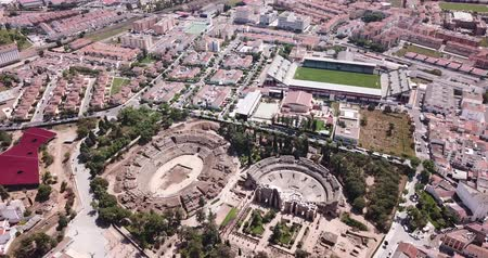 emerita : Aerial view of ruins of antique Roman amphitheatre and Theatre on background of modern Merida cityscape, Spain
