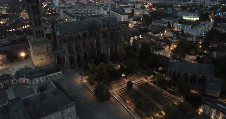 romanesk : Aerial view of illuminated Limoges cityscape with famous Cathedral in dusk Stok Video