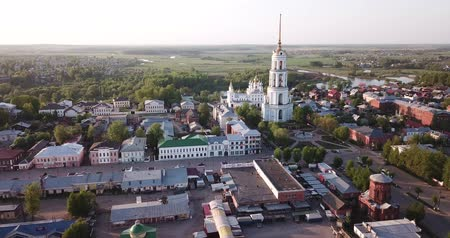 hristiyanlık : Scenic view from drone of Shuya cityscape on bank of Teza River with Resurrection Cathedral and belfry, Russia Stok Video